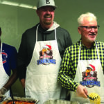 Cubs' Joe Maddon cooks for and serves 125 people in need at annual 'Thanksmas'